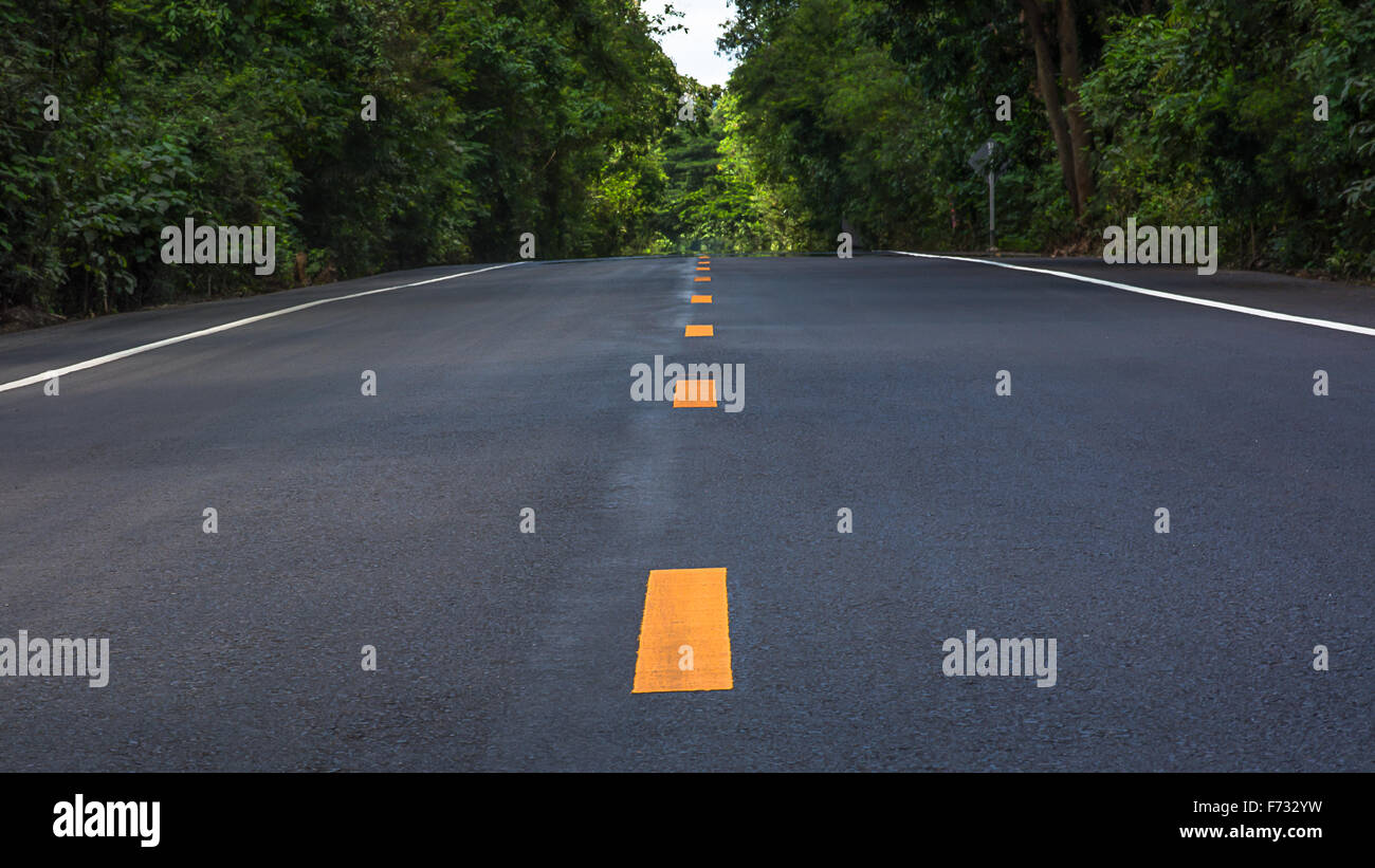asphalt pavements are designed and built to last. Most roads are constructed in layers, with each layer playing - Stock Image