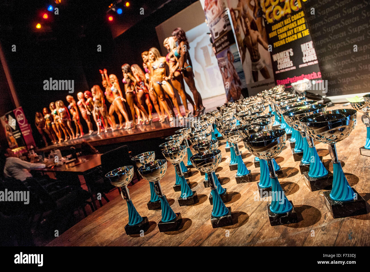 Female fitness models parade in bikini's at The Pure Elite Fitness Competition @ The Becks Theatre Hayes UK - Stock Image