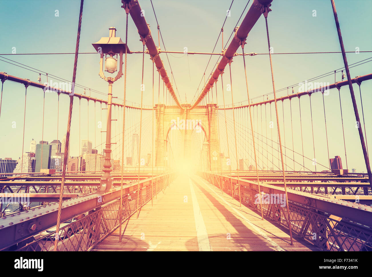 Vintage stylized picture of the Brooklyn Bridge in New York City, USA. - Stock Image