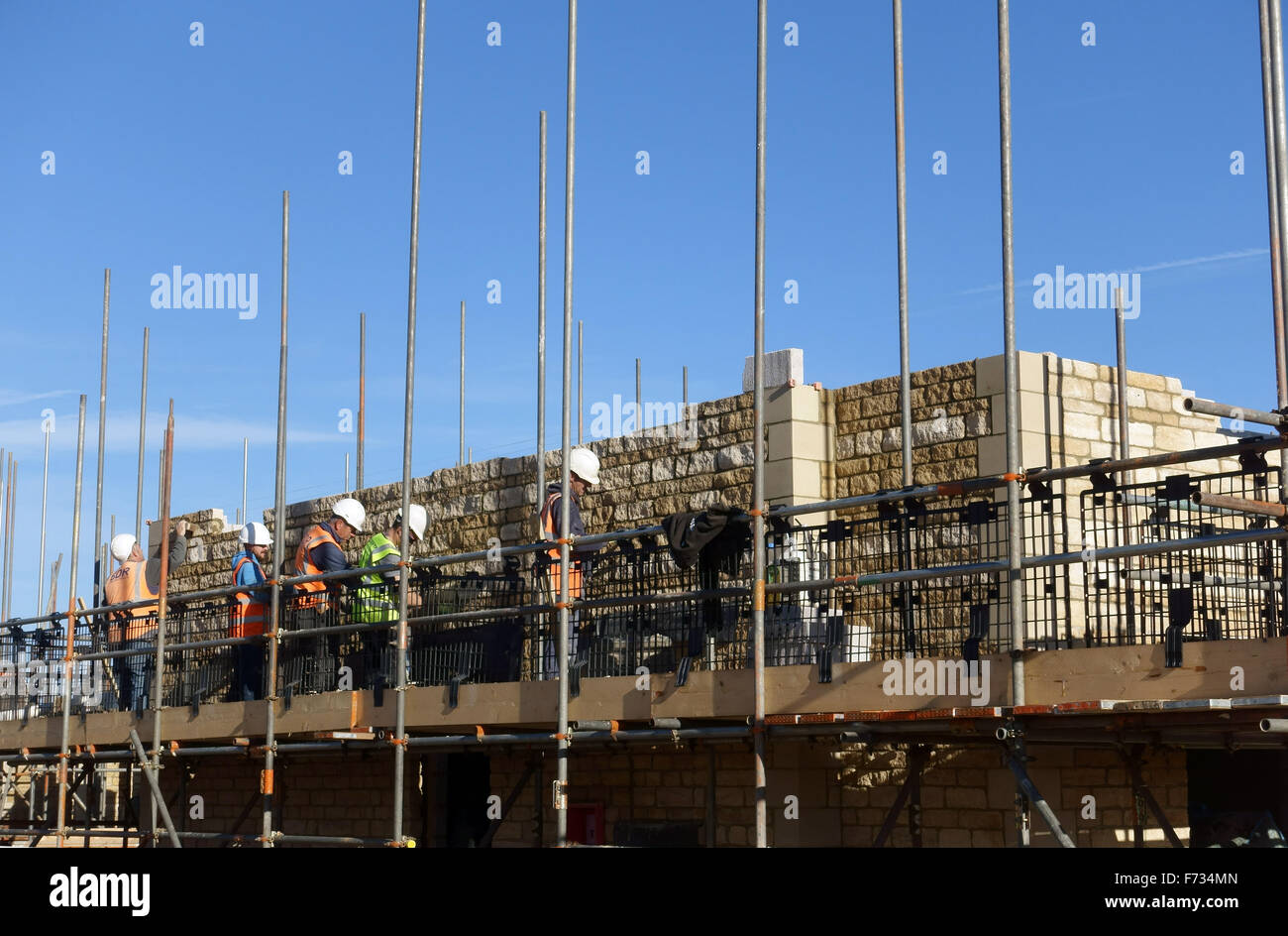 workmen building a new house - Stock Image