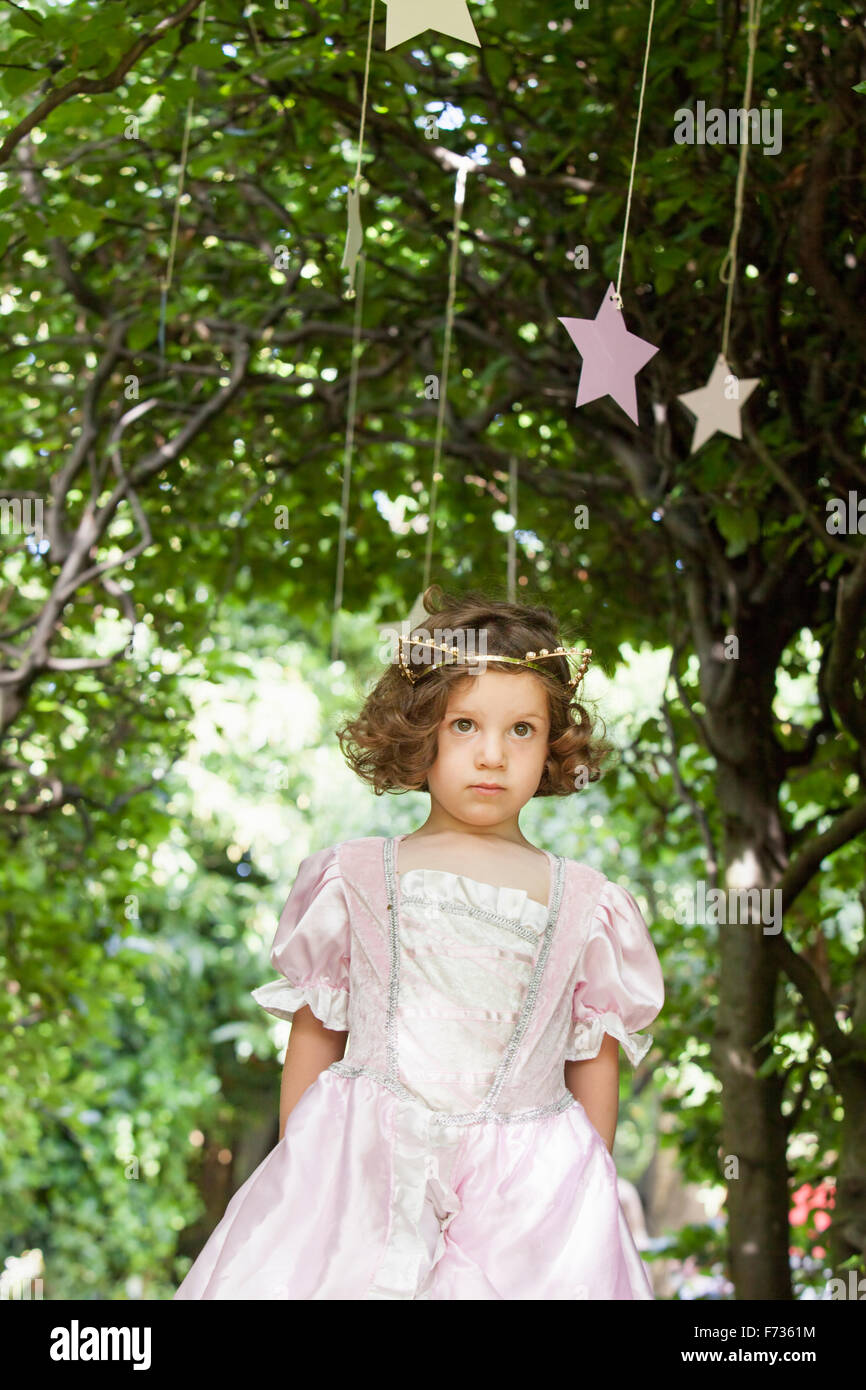 Young girl dressed as a fairy at a party in a garden. - Stock Image