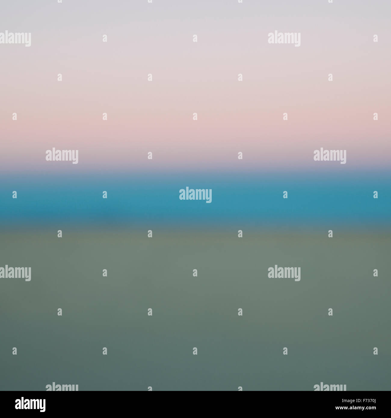 View across the sky and the horizon line at dawn in the desert. - Stock Image