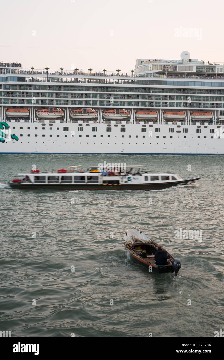 Huge Cruise liner arriving in St Marks Basin, The Riva Degli Schiavoni,  early evening, Venice, Italy. - Stock Image