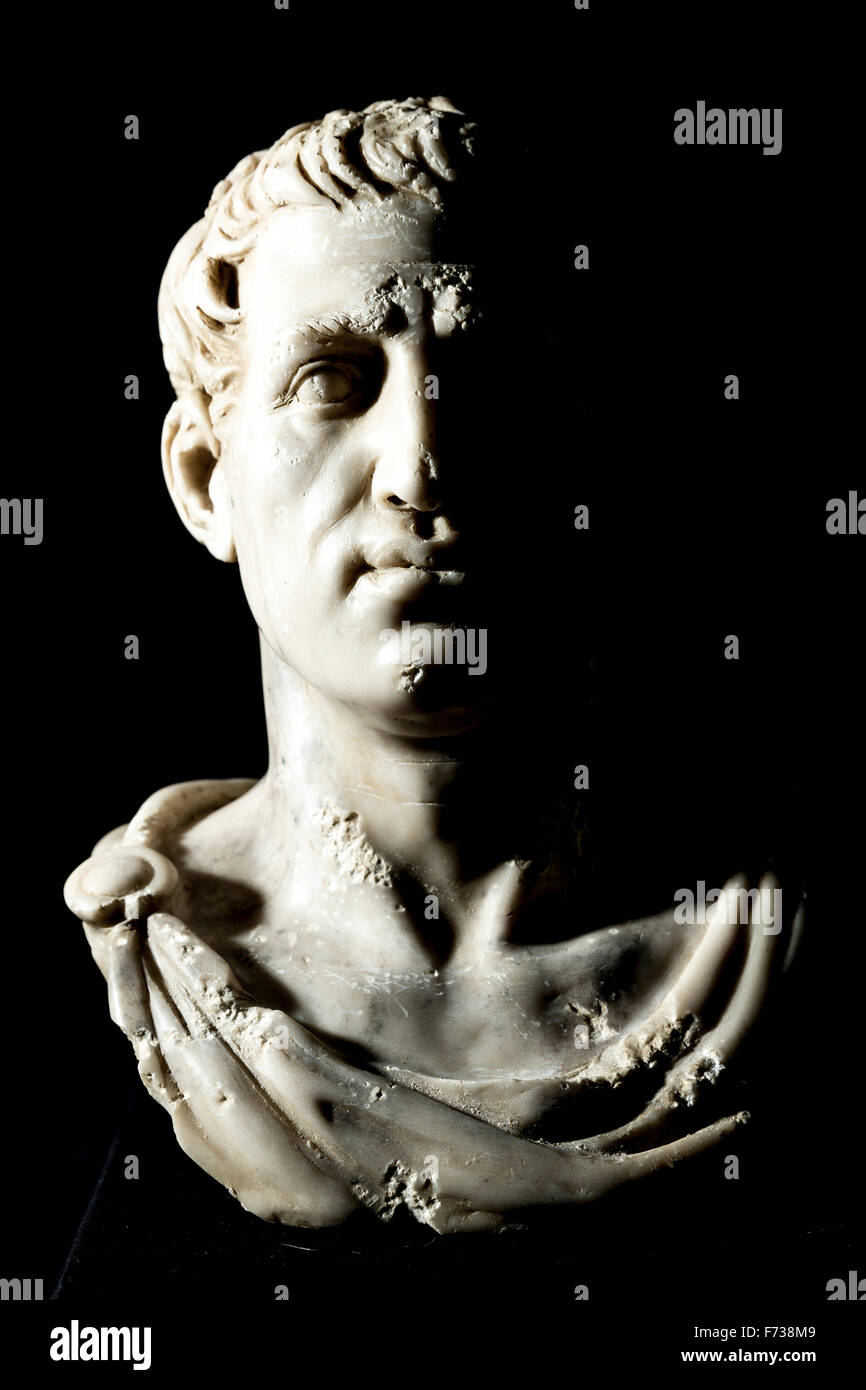 Low Key Photograph of Bust of Emperor Gaius Julius Caesar (13 July 100 BC to 15 March 44 BC) on Black Background. - Stock Image