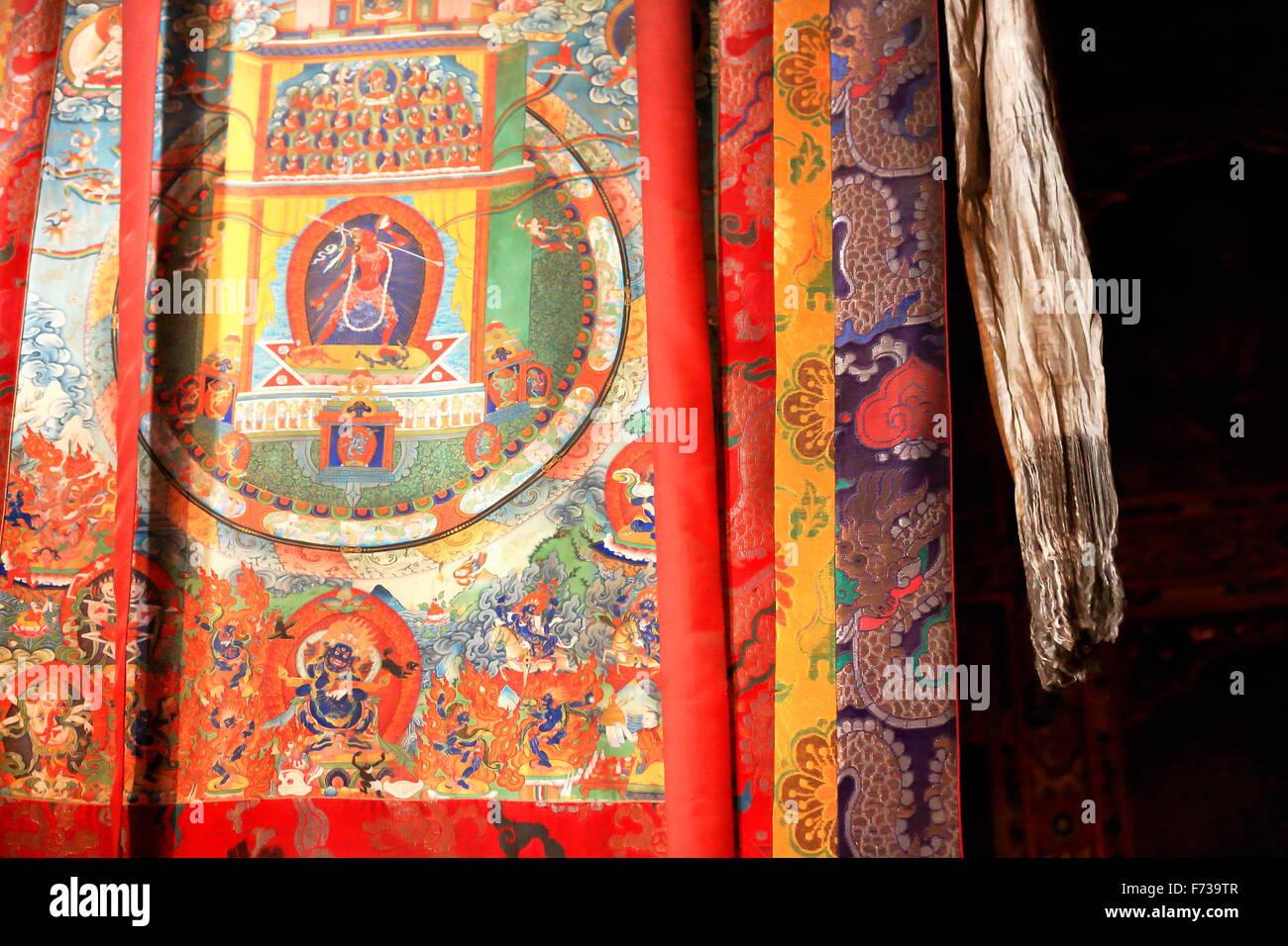 Wall hanging tibetan silk thangka in shrine on Ponpori Hill-right bank of Trum or Chong chu river-grounds of Sakya - Stock Image