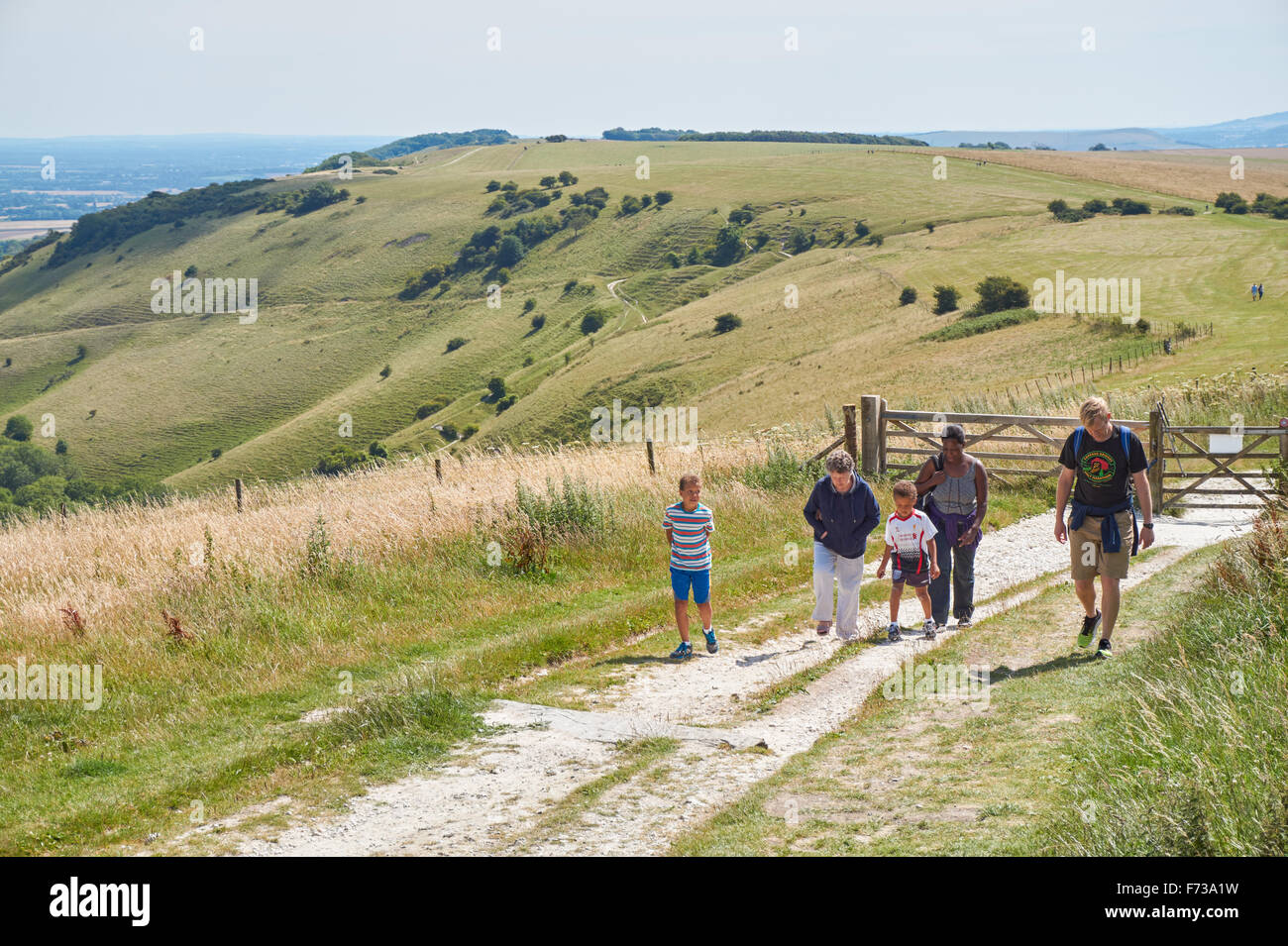Walkers at Ditchling Beacon The South Downs National Park East Sussex England United Kingdom UK - Stock Image
