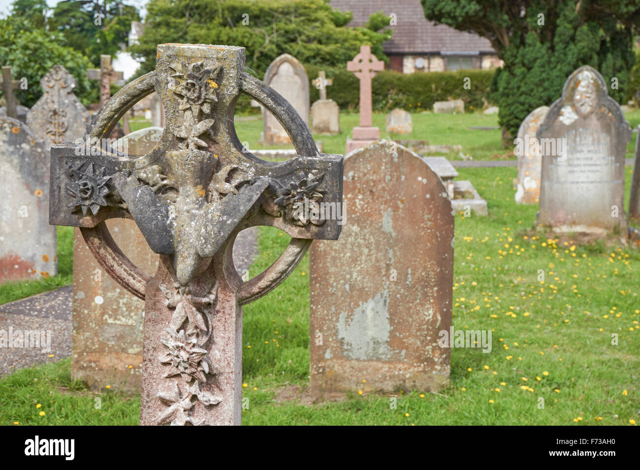 Saint Cosmas and Saint Damian Church cemetery in the village of Keymer, West Sussex England United Kingdom UK - Stock Image