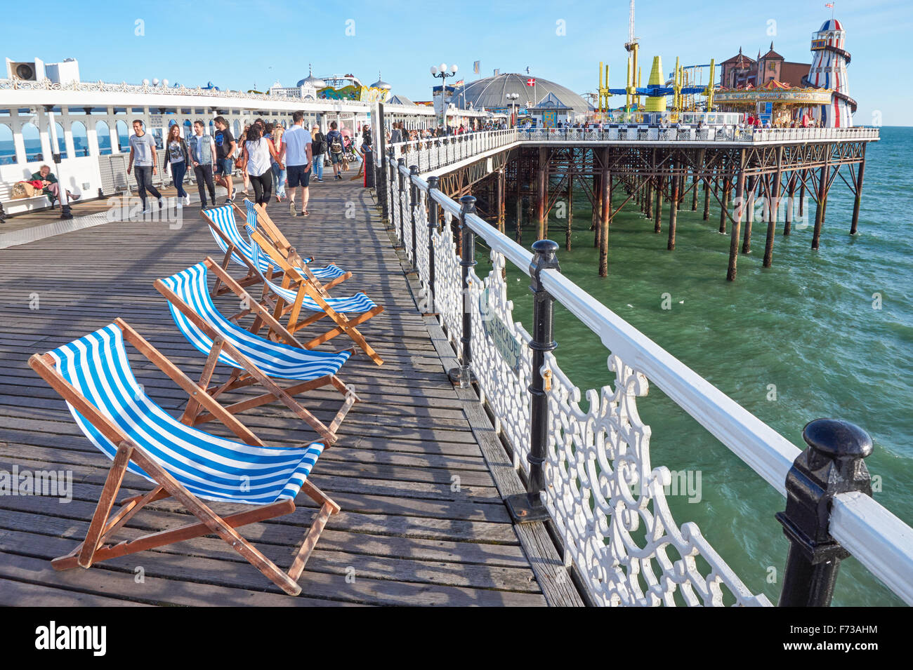 Deckchairs on Brighton Pier,  East Sussex England United Kingdom UK - Stock Image