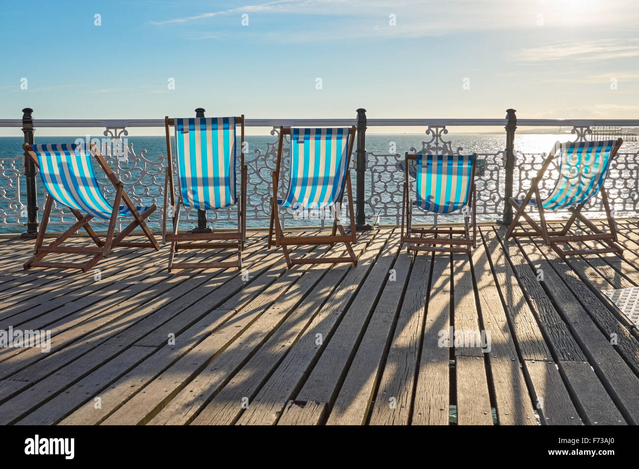 Empty deckchairs on Brighton Pier,  East Sussex England United Kingdom UK - Stock Image