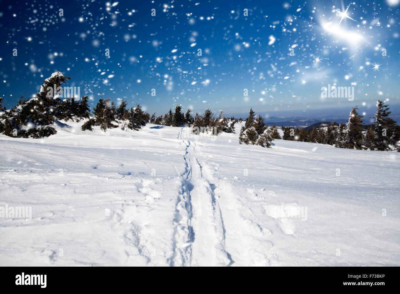 Snowy path on the hillside and beautiful abtract blue sky - Stock Image