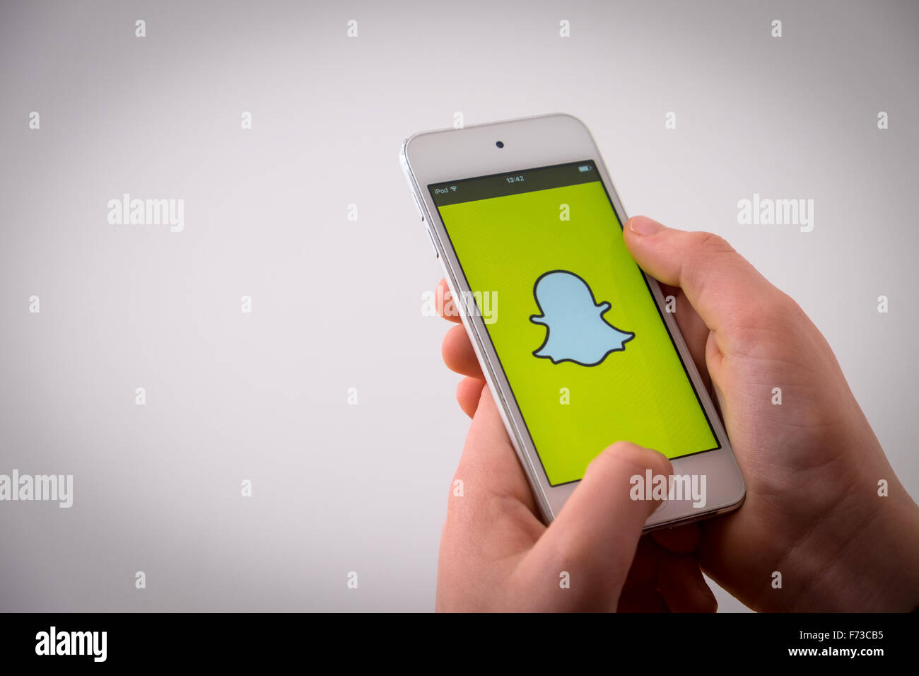 A boy using the app Snapchat - Stock Image