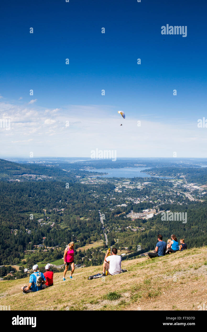 Poo Poo Point is a tourist attraction near Issaquah, WA where hang gliders launch into the clear sky above a thick - Stock Image