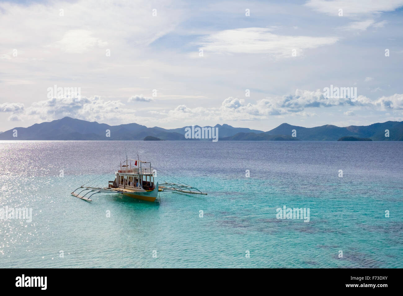 Outrigger boat anchored at Cauayan Island, Philippines - Stock Image