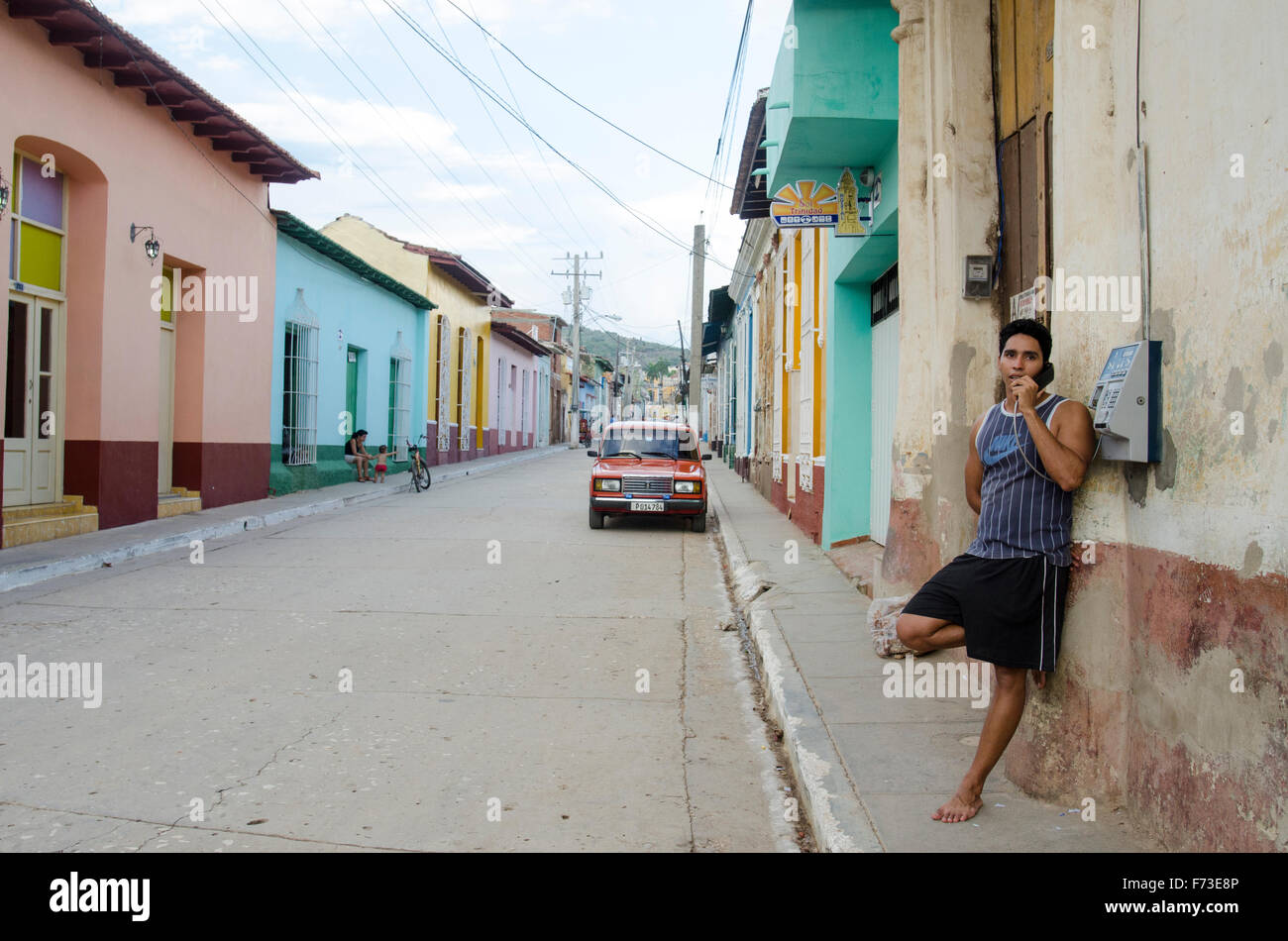 A man talks on a pay phone in Trinidad, Cuba. - Stock Image