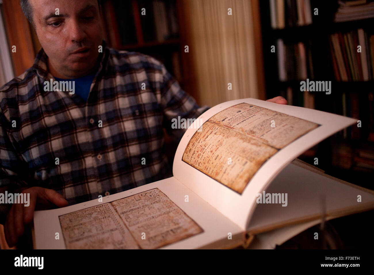 Entomologist Joao Pedro Cappas e Sousa shows a copy of the Mayan Madrid Codex - Stock Image