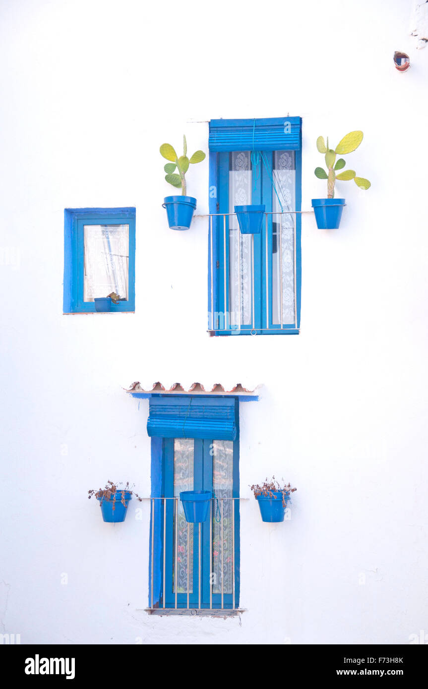 Whitewashed facade with blue windows typical in the mediterranean coast - Stock Image