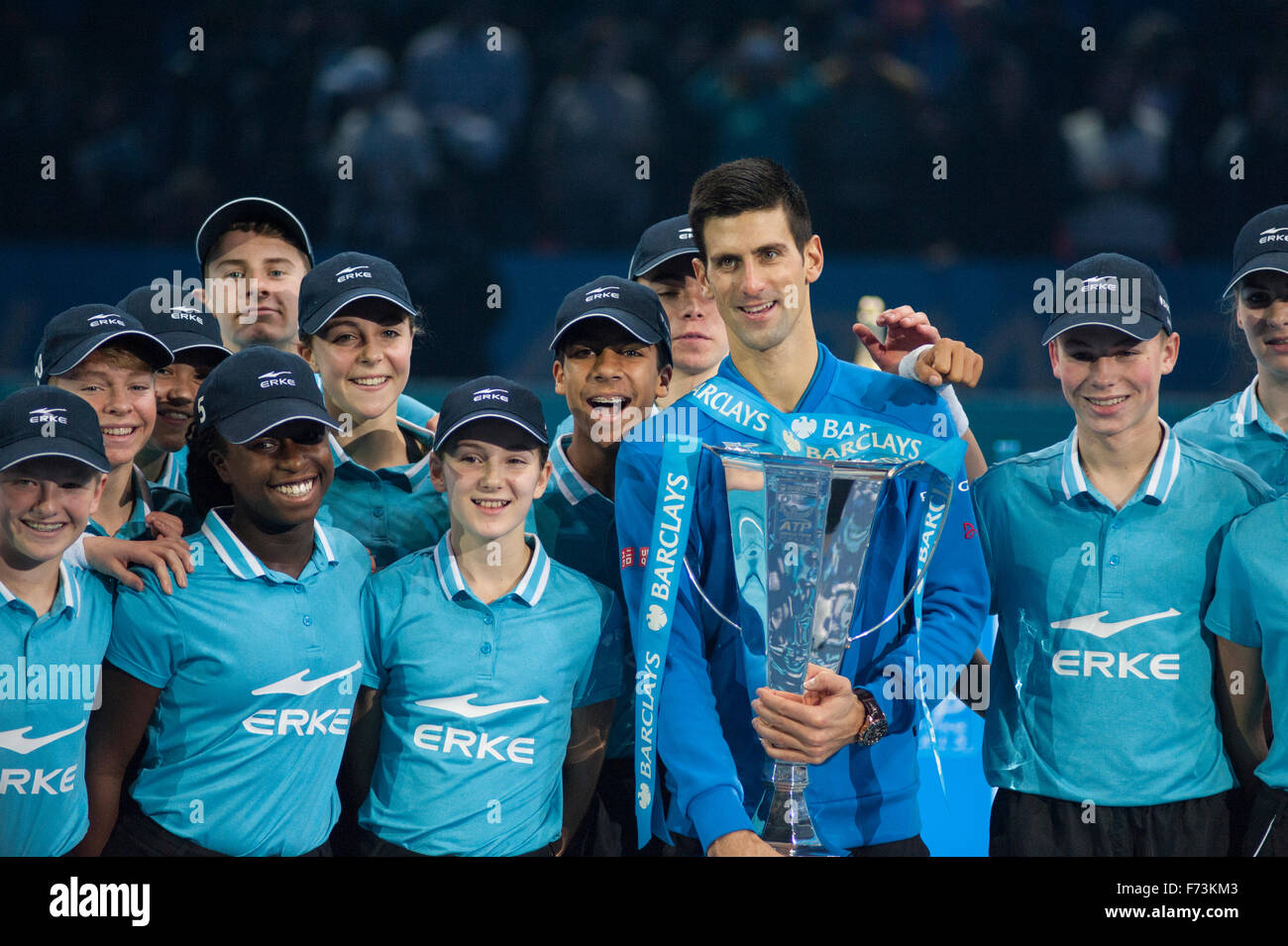 Barclays ATP World Tour Finals 2015. Singles winner Novak Djokovic on court with the Trophy surrounded by Barclays - Stock Image