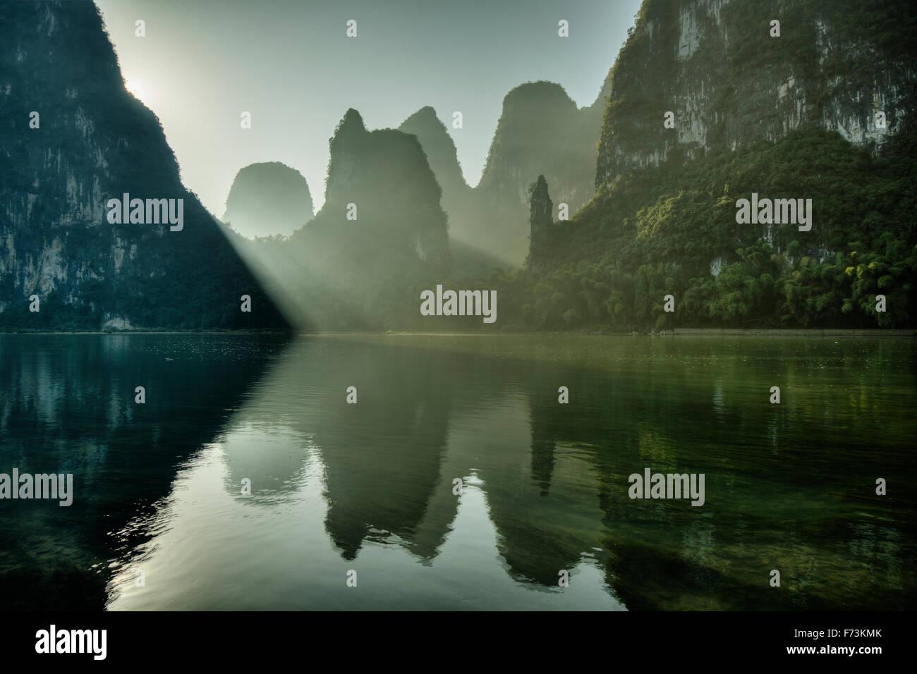 Limestone Karst Formations reflected in River Li Guilin Region Guangxi, China LA007958 Stock Photo