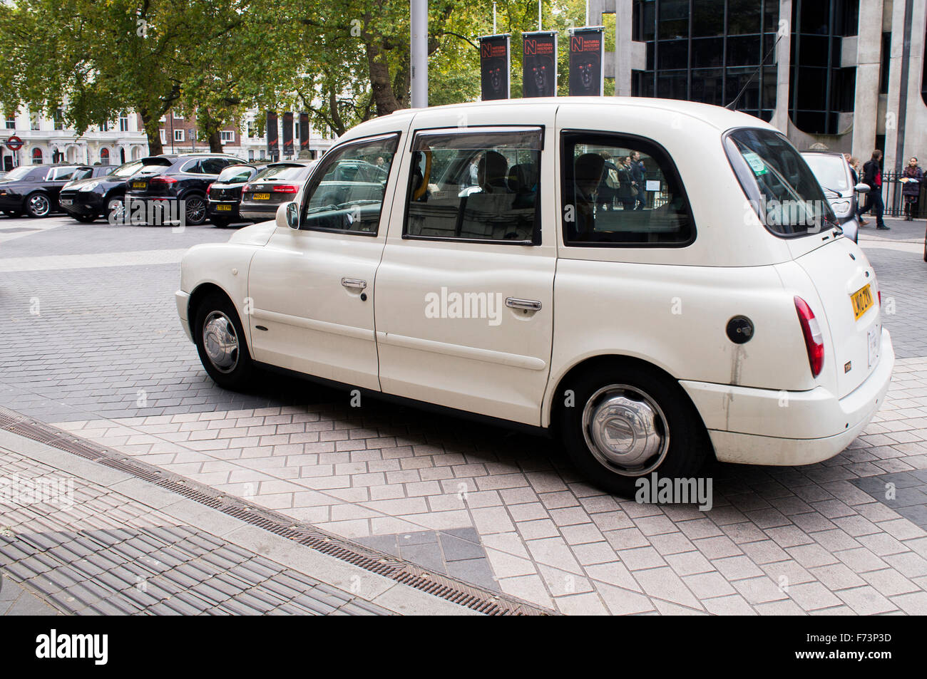 London taxi, hackney carriage, white cab, hack - Stock Image