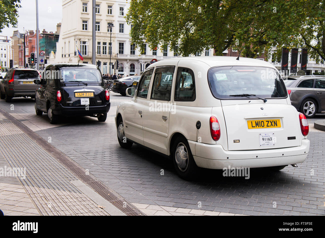 London taxi, hackney carriage, white, black cab, hack - Stock Image