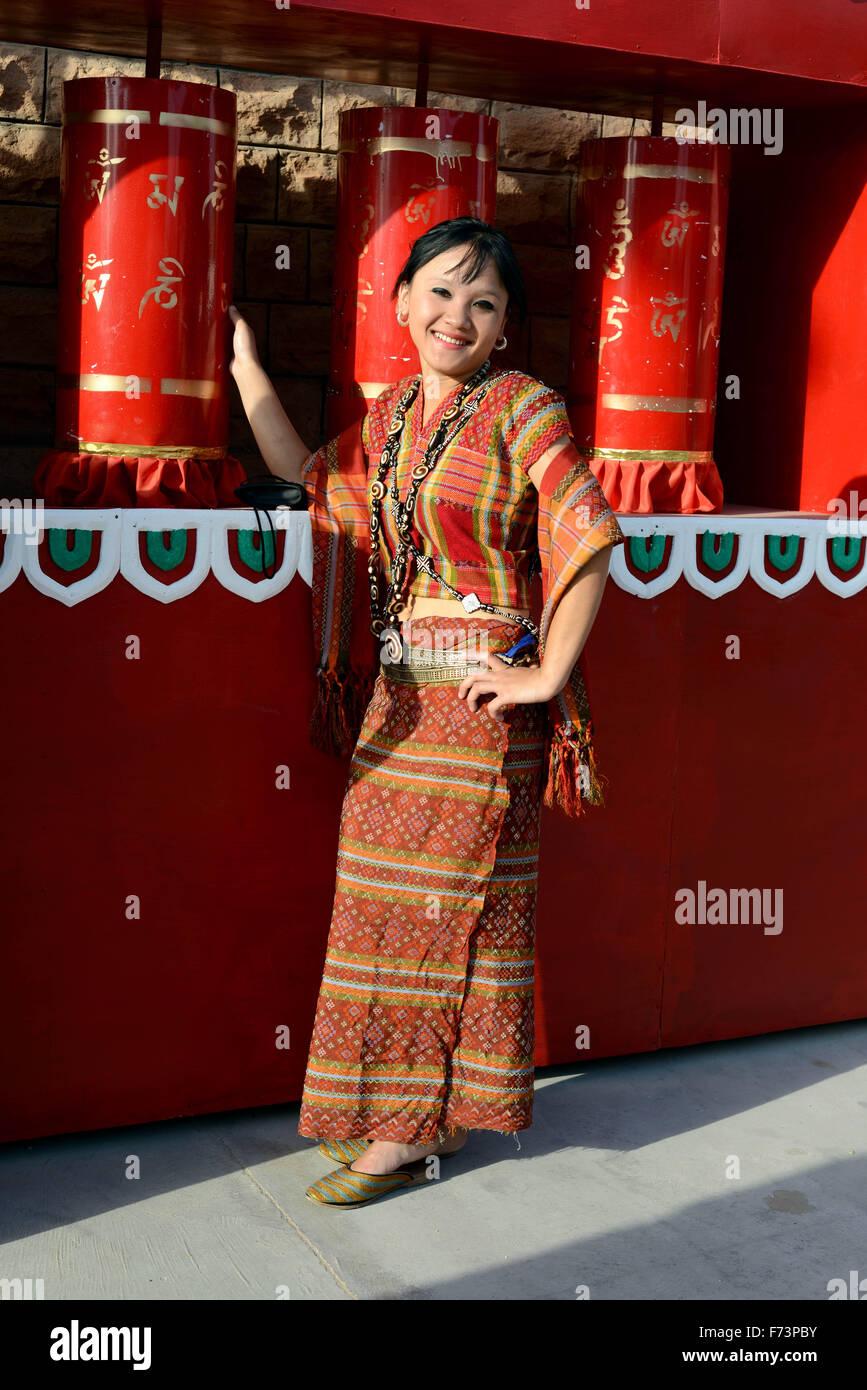 Woman turns prayer wheels, buddhist temple, india, asia, mr#786 - Stock Image