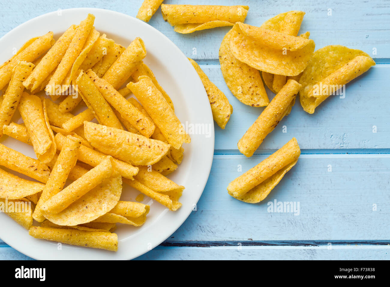 rolled nacho chips on table - Stock Image
