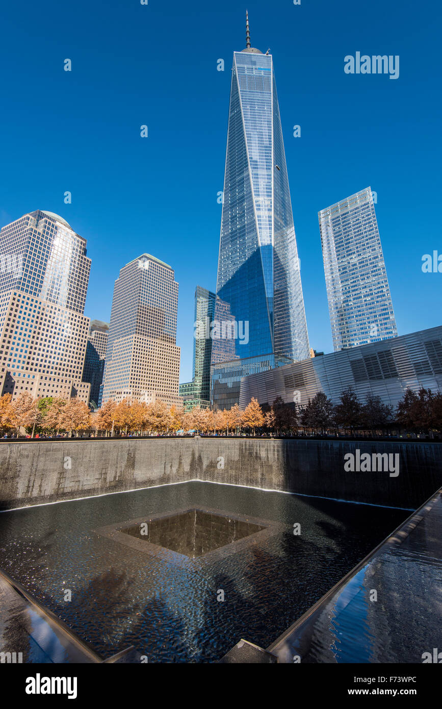 Southern Pool of National September 11 Memorial & Museum with One World Trade Center behind, Lower Manhattan, New Stock Photo