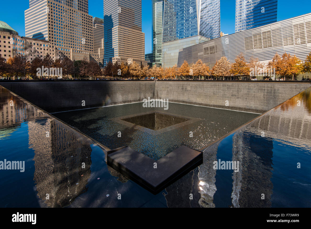 Southern Pool of National September 11 Memorial & Museum with One World Trade Center behind, Lower Manhattan, - Stock Image