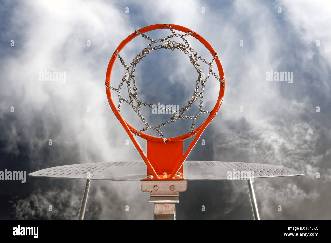 Abstract image of basketball goal against the sky - Stock Image