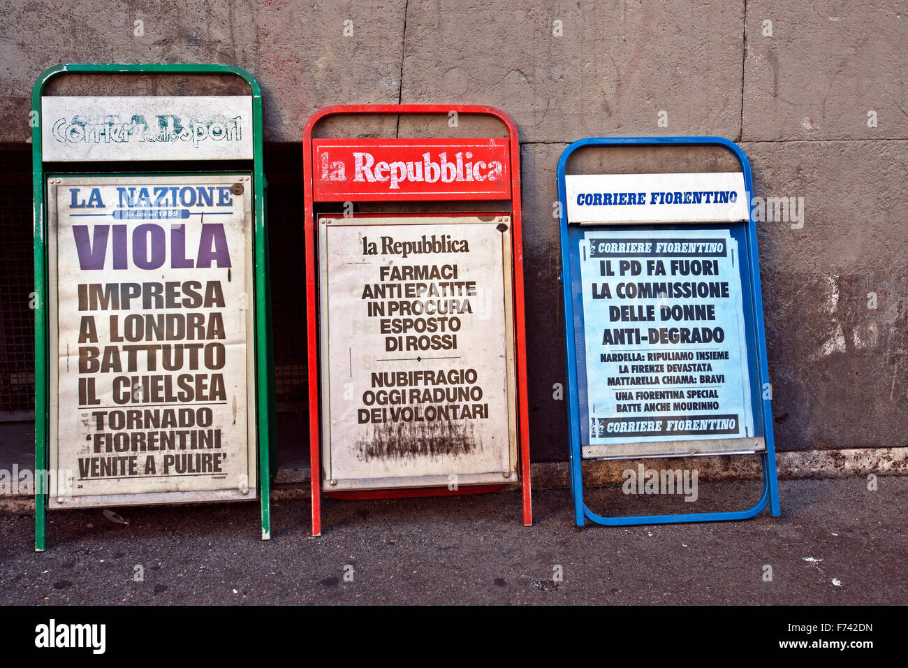 Italian newspaper headline advertising boards - Stock Image