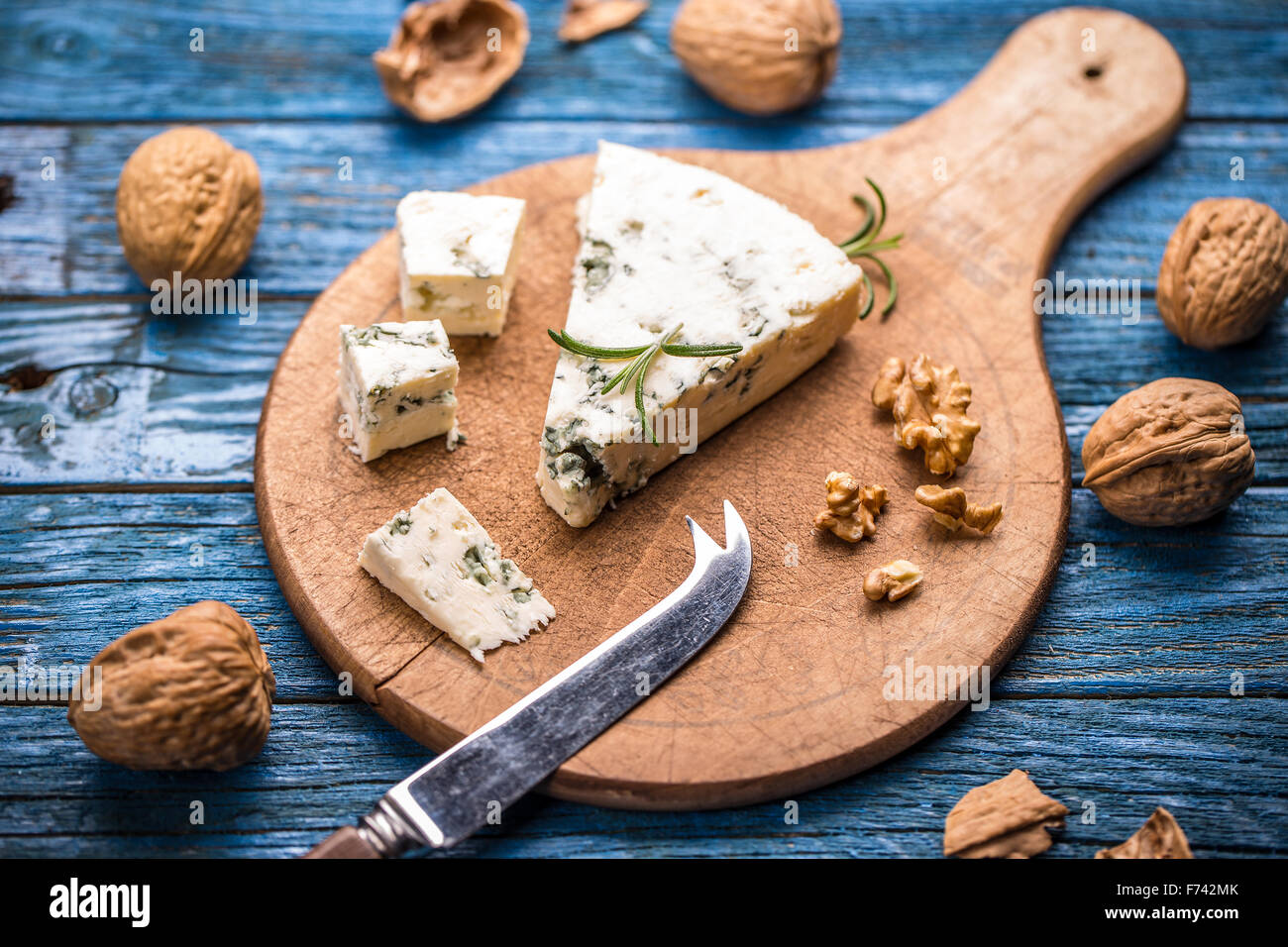 Blue cheese on wooden cutting board - Stock Image