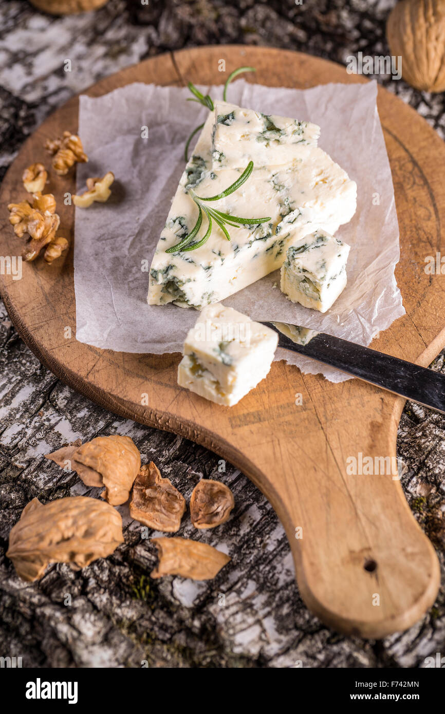 Gorgonzola cheese with rosemary and walnuts - Stock Image