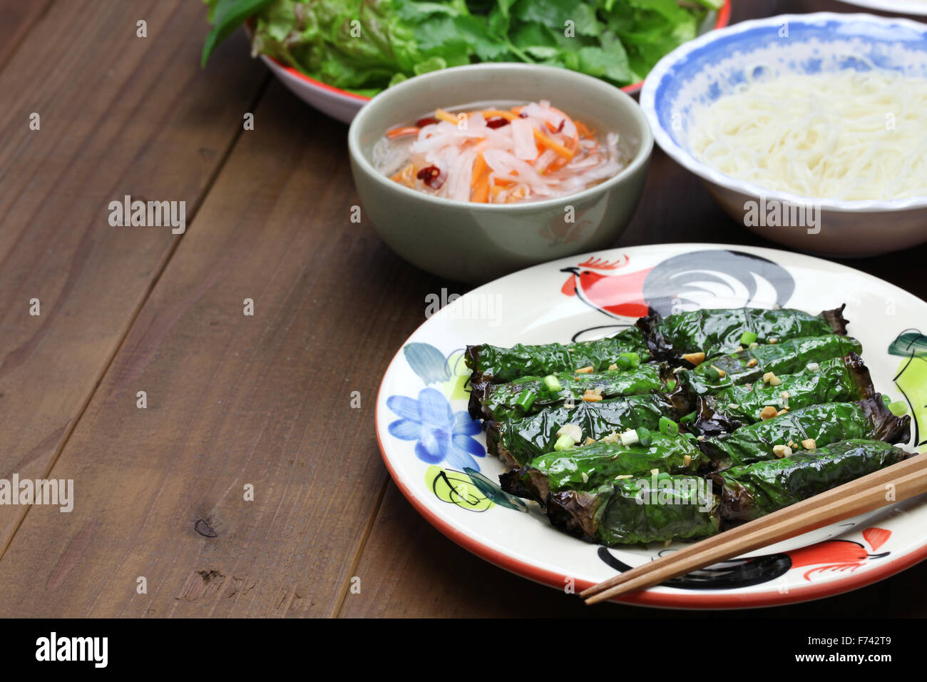 grilled minced beef wrapped in betel leaf, vietnamese cuisine, thit bo nuong la lot Stock Photo