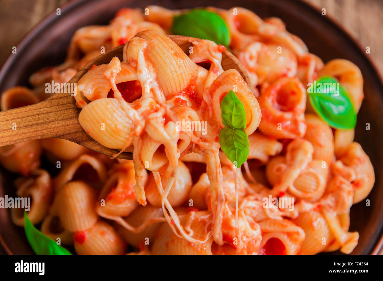 pasta with tomato sauce and cheese - Stock Image