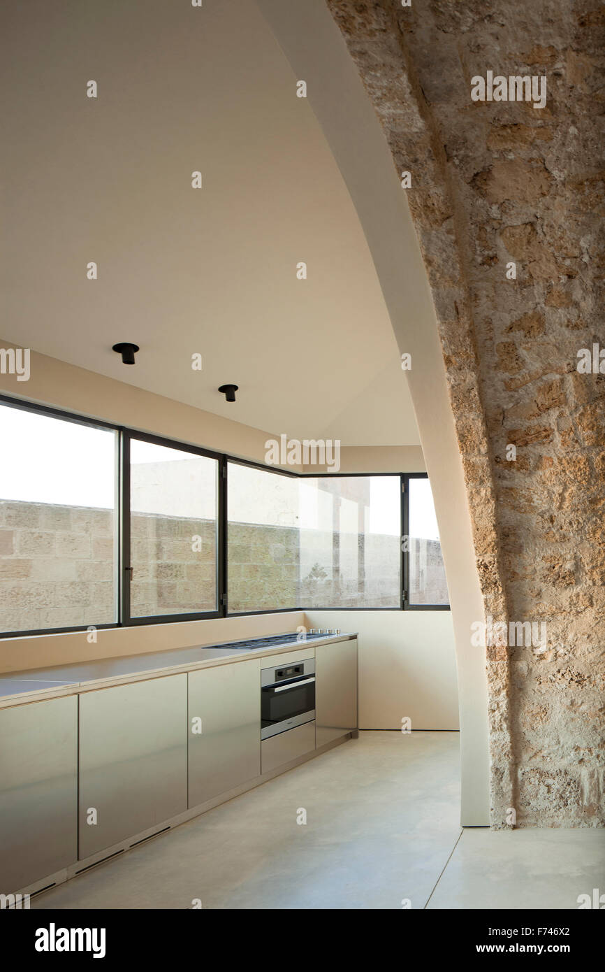 Exposed Stone Arch And Minimalist Kitchen In House Jaffa Tel Aviv