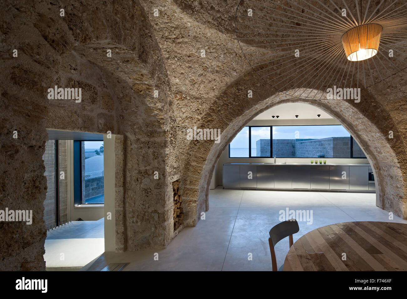 Modern Rustic Exposed Stone Arch And Minimalist Kitchen With Stock