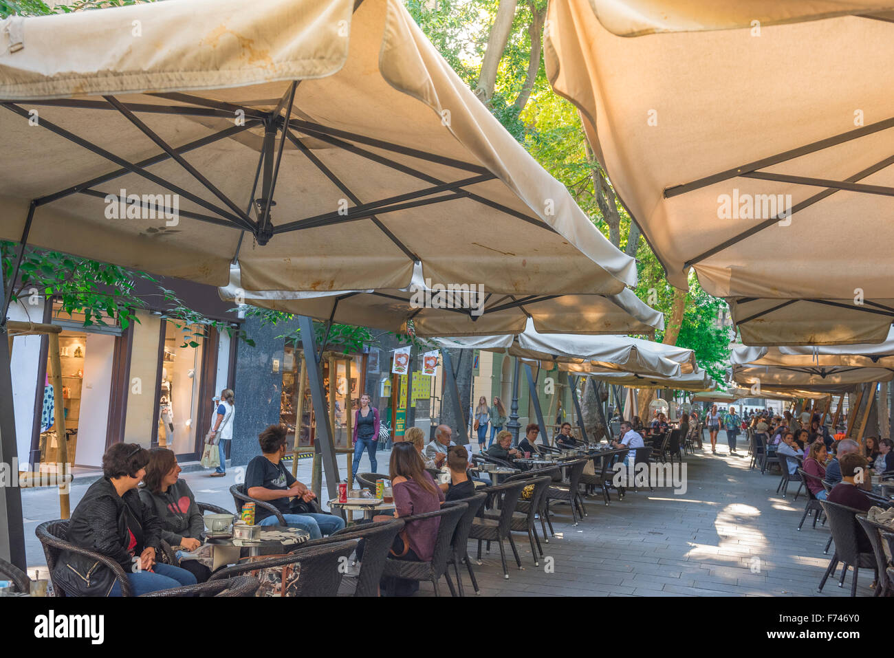 The Viale XX Settembre in the centre of Trieste, Italy, is a 200 metre long boulevard full of cafes and bars. - Stock Image