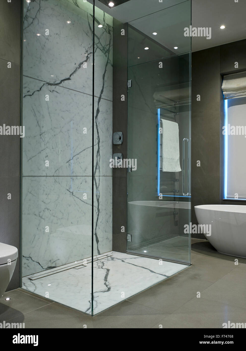 Shower cubicle in bathroom of Chelsea Apartment, London, England, UK - Stock Image