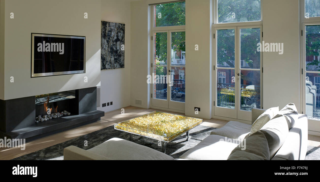 Gold leaf coffee table in living room of Chelsea Apartment, London, England, UK - Stock Image