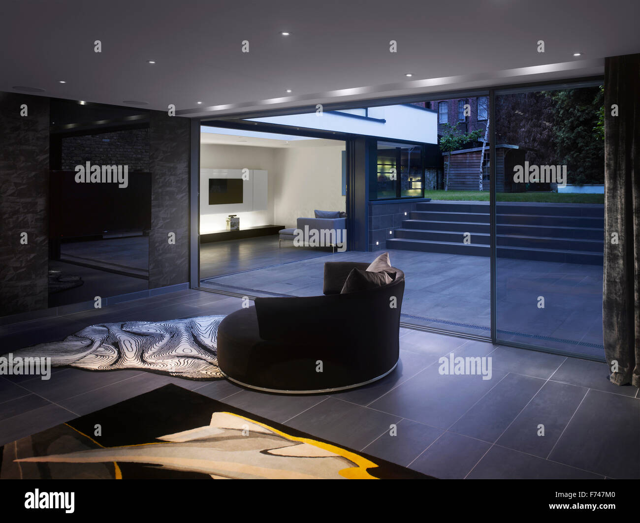 Night shot between the lounges in Holland Park House by Paul Archer Design, London, England, UK - Stock Image
