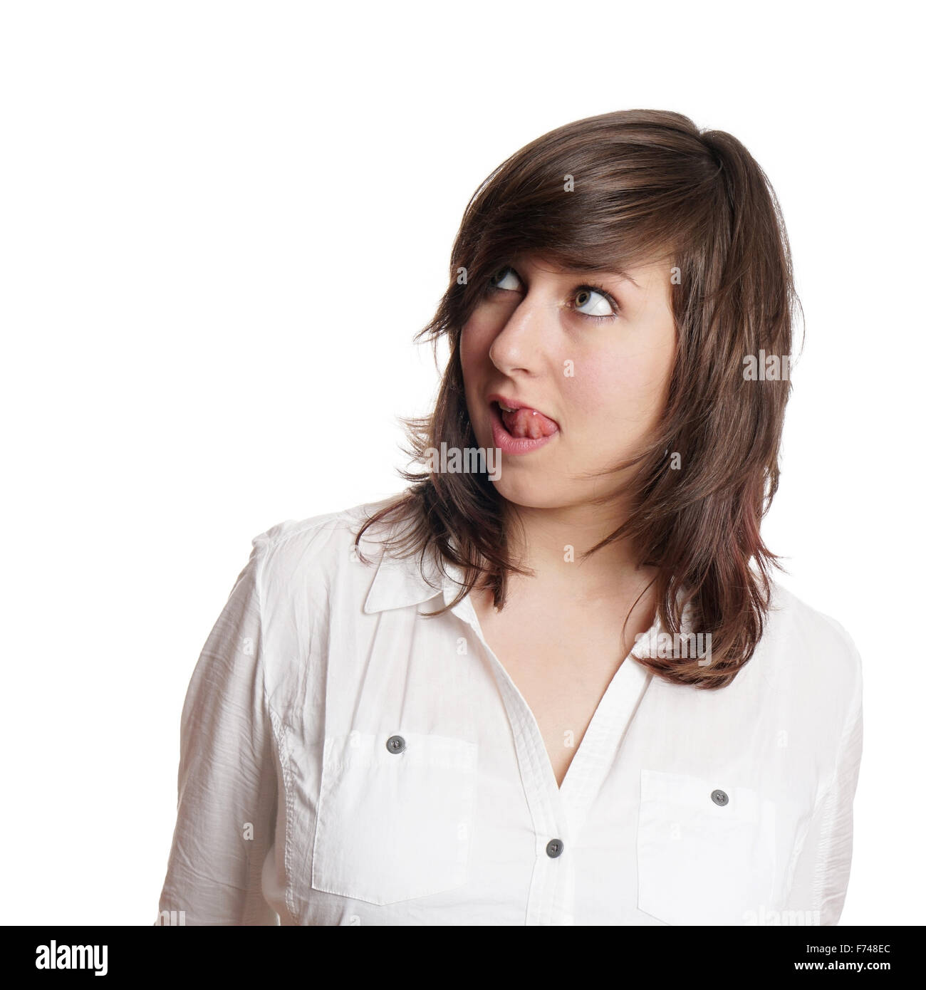 woman licking lips and looking up - Stock Image