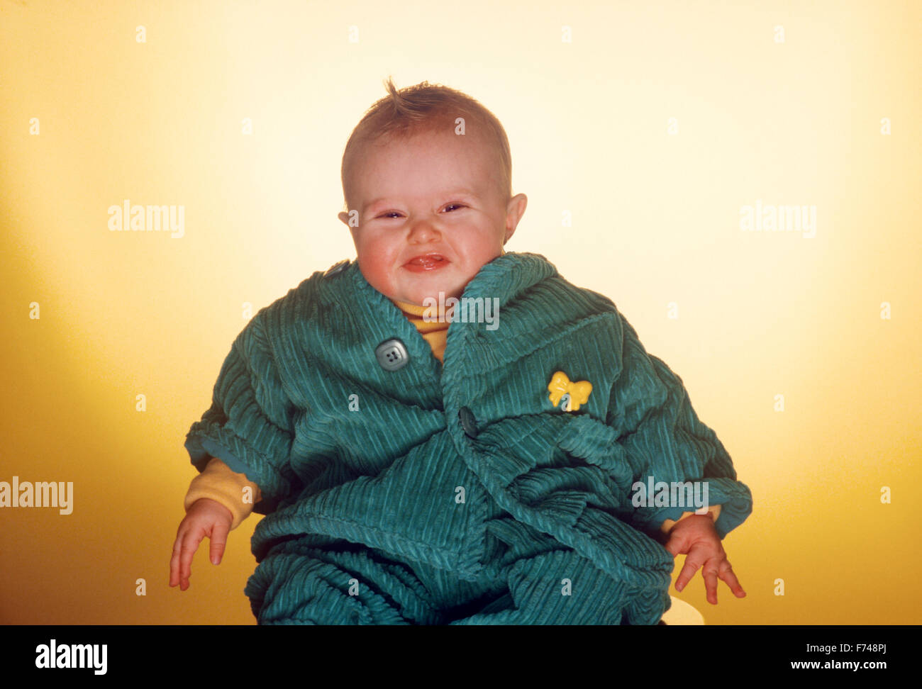 portrait of happy chubby baby - Stock Image