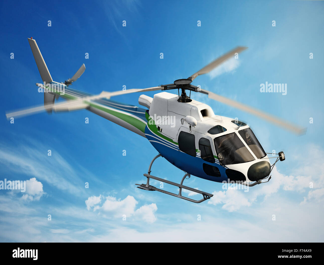 Helicopter flying through the sky - Stock Image