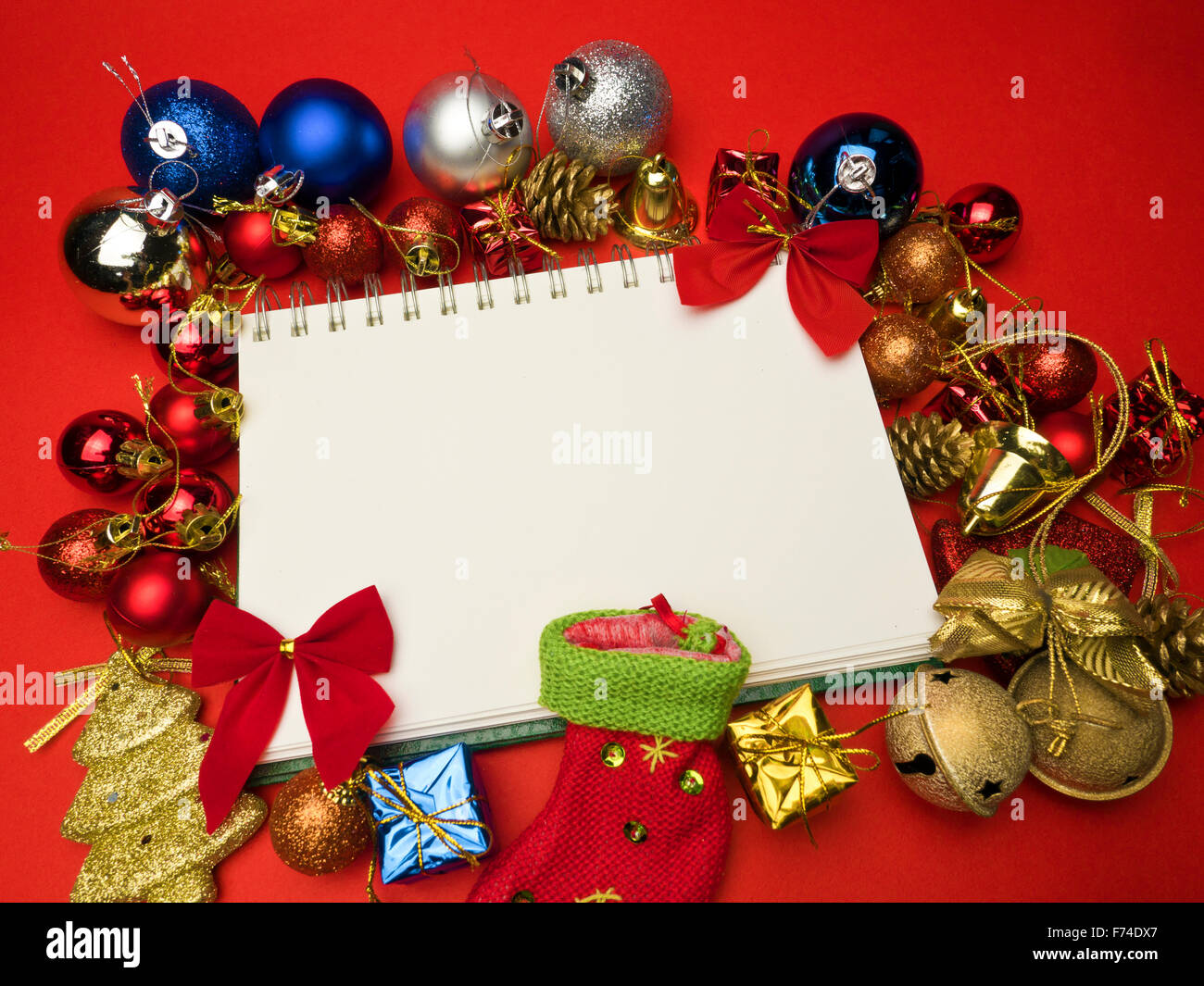 christmas card conception with diversity decorations on red background Stock Photo