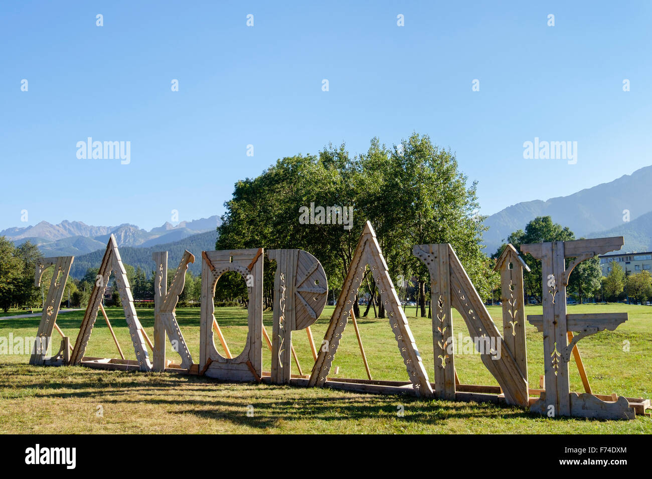 Free standing letters spelling town name sign in a park with high Tatra mountains behind. Zakopane, Tatra County, - Stock Image