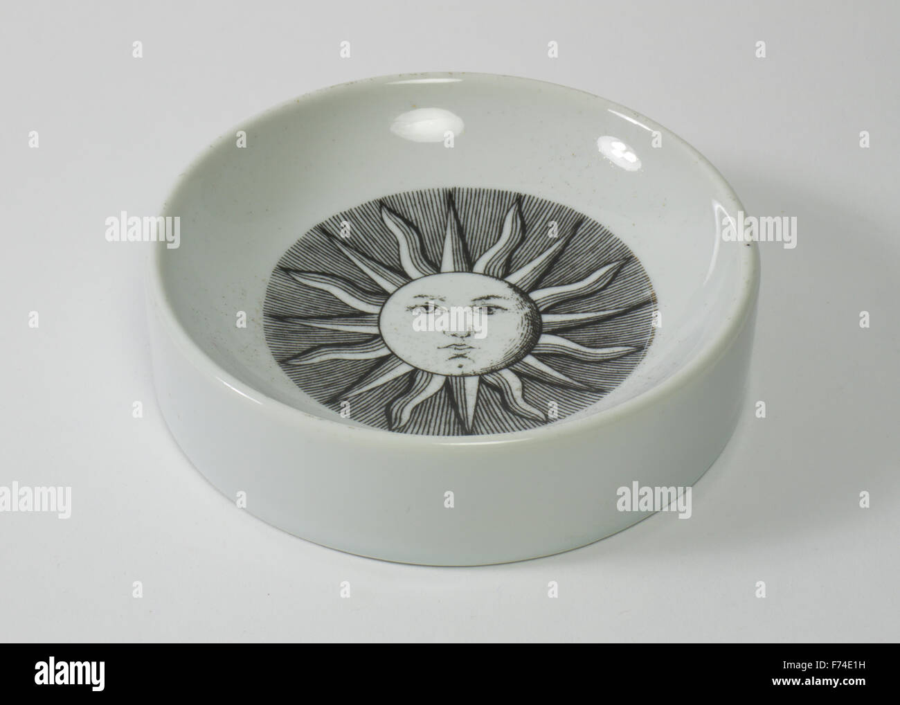 Fornasetti porcelain bowl decorated to the interior with the sun. The bowl measures 13cm in diameter and is 33mm - Stock Image