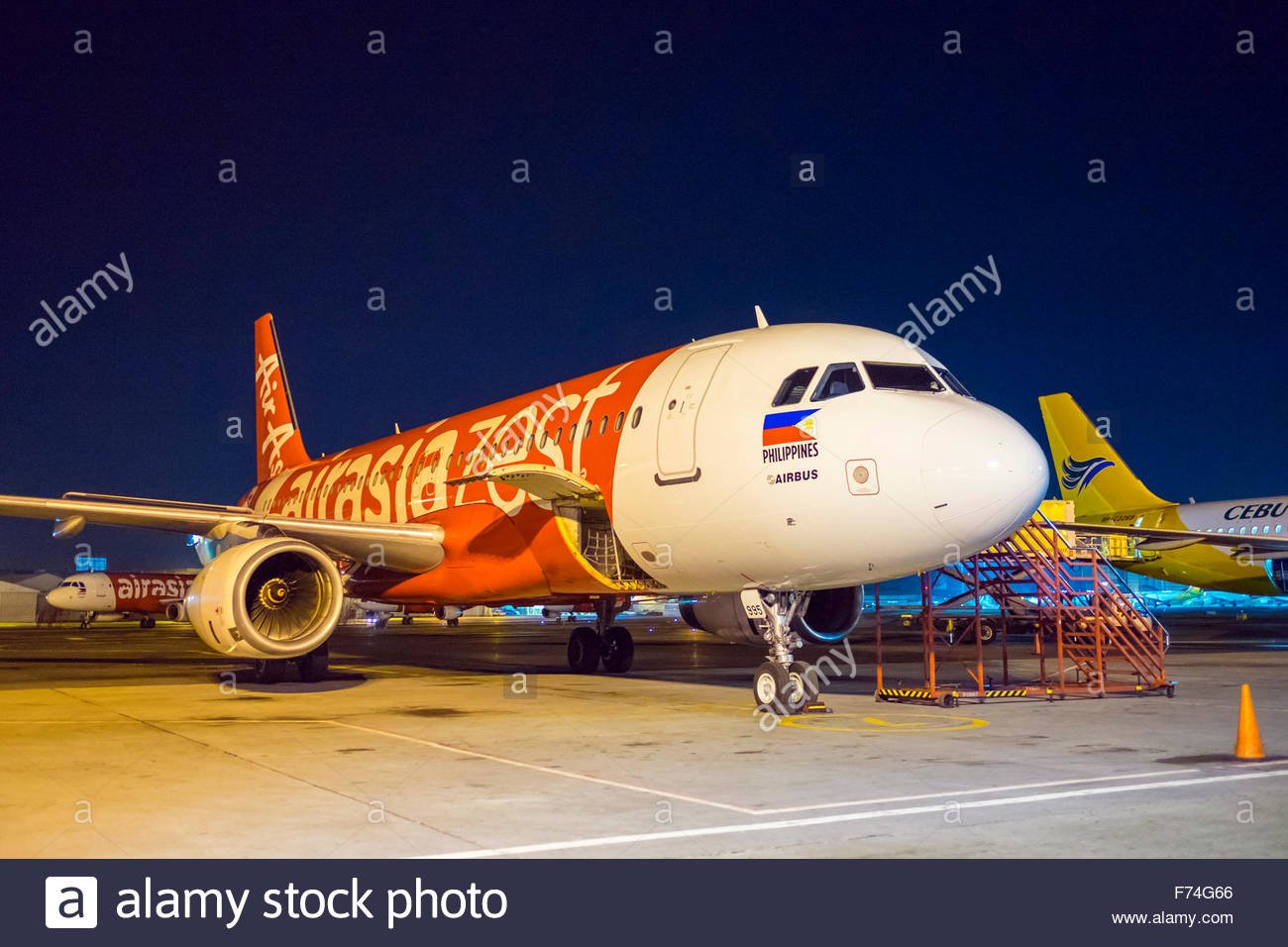 Planes at Ninoy Aquino International Airport at night, Manila International Airport, Pasay, Metro Manila, Philippines - Stock Image