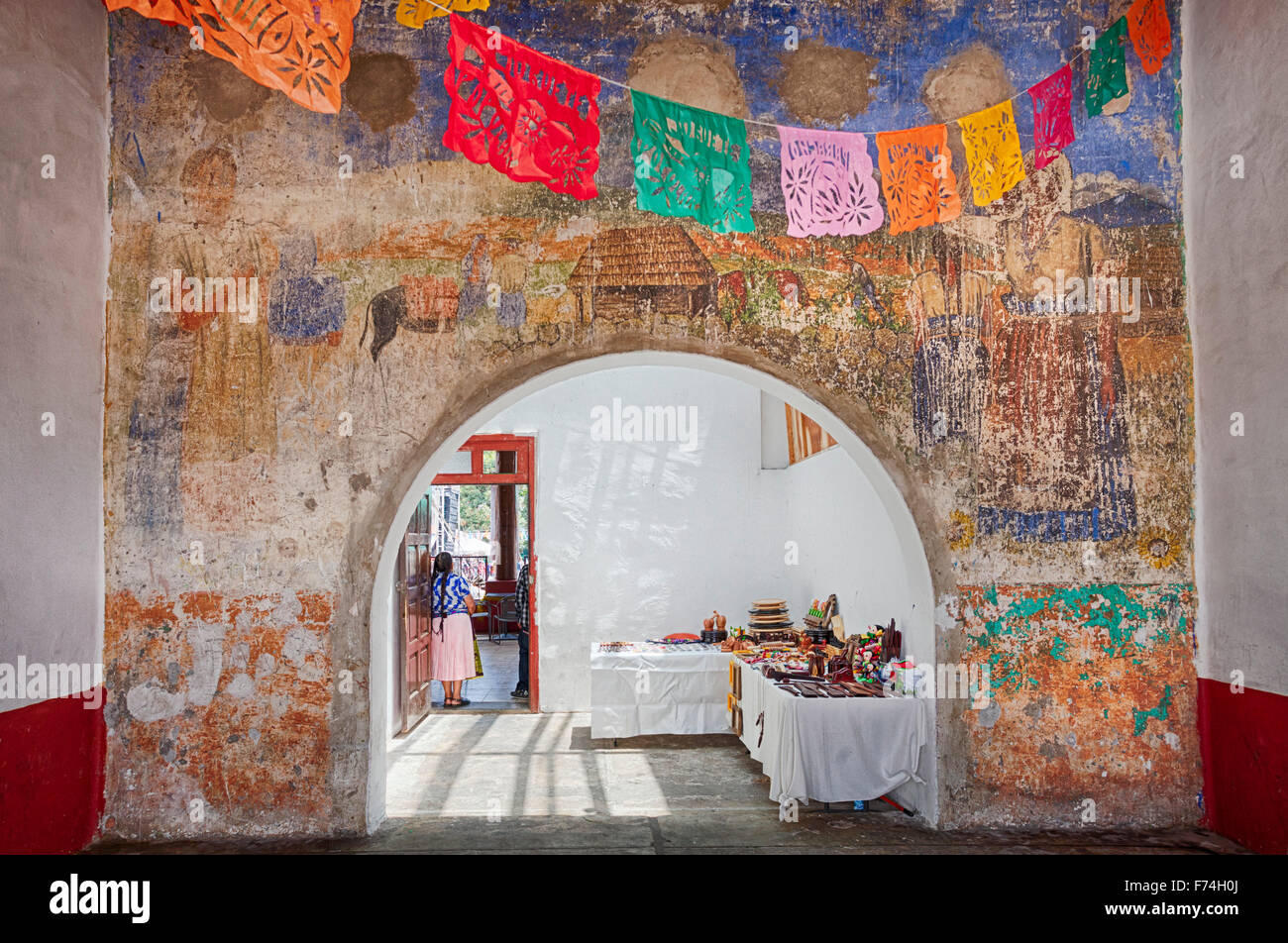 Faded mural and archway in the town known for its guitar makers, Paracho, Michoacan, Mexico. - Stock Image