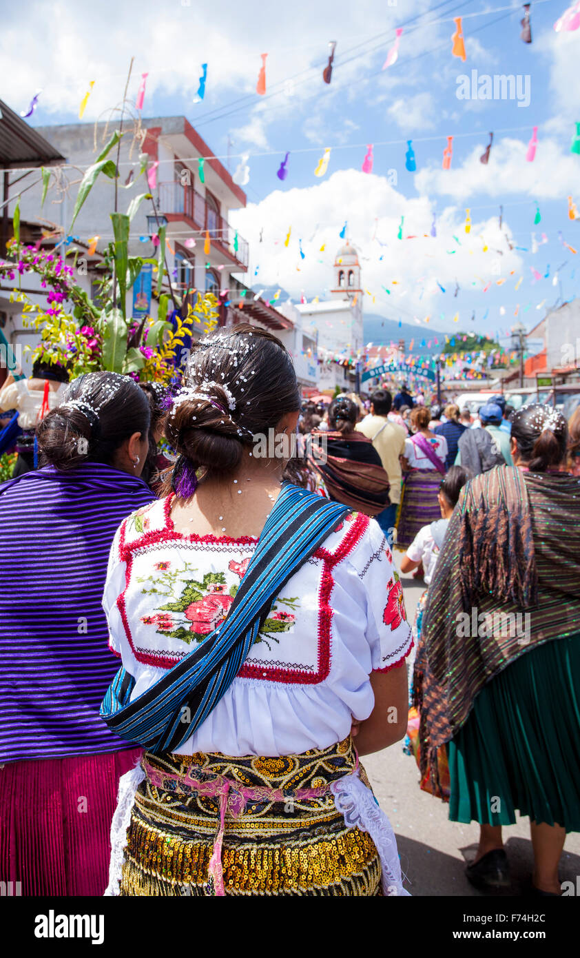 A festively dressed woman participates in the Guitar Festival parade in Paracho, Michoacan, Mexico. - Stock Image