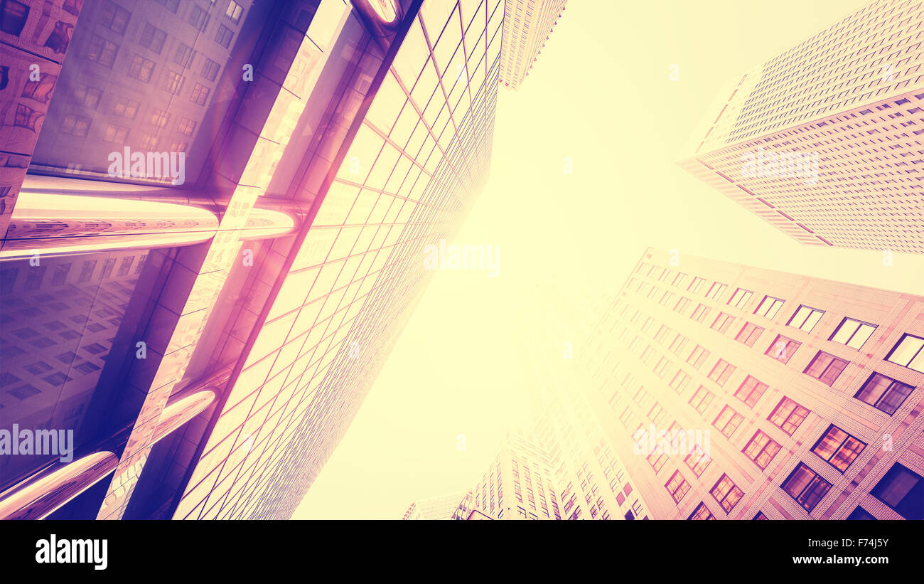 Vintage toned skyscrapers against sun with lens flare effect, NYC. - Stock Image